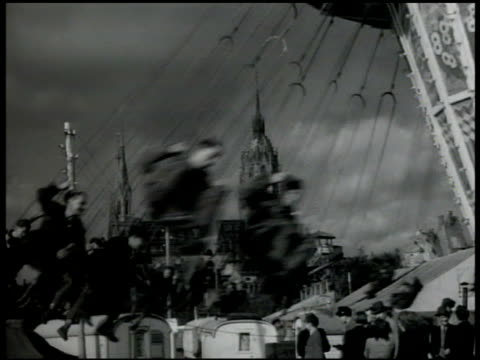 adults riding 'highflying' swing ride swings swinging through frame vs us occupational soldiers w/ dates sitting in swing rotating ride some holding... - 1947 stock-videos und b-roll-filmmaterial