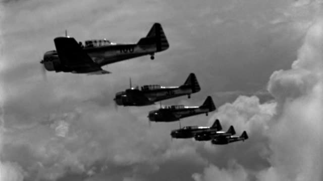 wwii advanced trainer aircraft fly in echelon formation. - military training stock videos & royalty-free footage