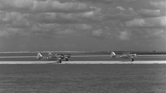 wwii advanced trainer aircraft taxi over a runway at kelly air force base. - 1943 stock videos & royalty-free footage