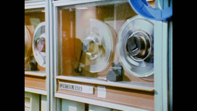 stockvideo's en b-roll-footage met advances in computer, communications and engineering technology used in space can be used on earth - 1973