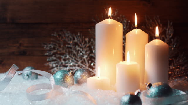advent red candles on snow with vintage wood - number 4 stock videos & royalty-free footage