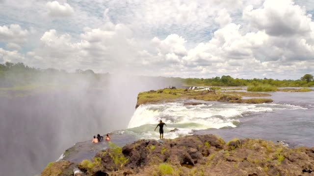adventure at the edge of victoria falls - victoria falls stock videos and b-roll footage
