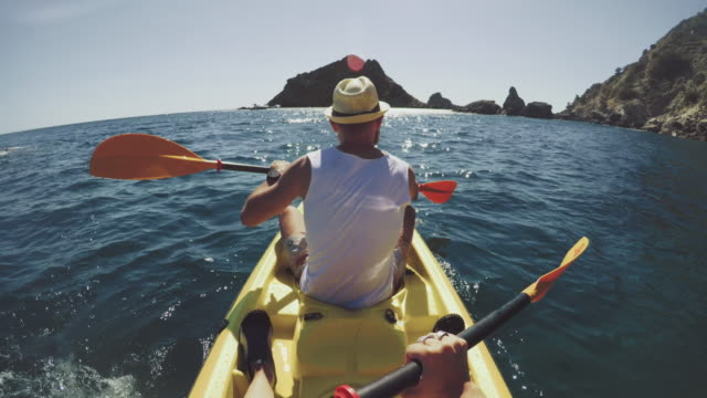 pov adventure: kayaking in a summer sea - kayak stock videos & royalty-free footage