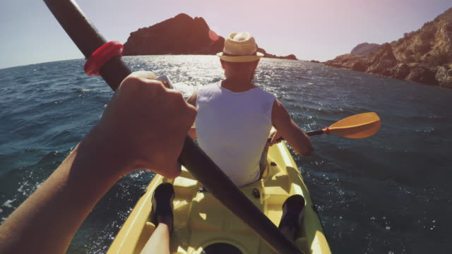 POV adventure: kayaking in a summer sea