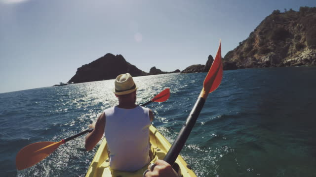 pov adventure: kayaking in a summer sea - canoe stock videos & royalty-free footage