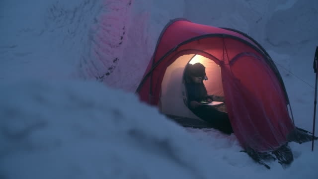 adventure seeker planning mountaineering route - tent stock videos and b-roll footage