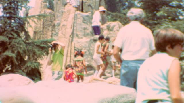vídeos y material grabado en eventos de stock de adventureland / jazz band / tomorrowland / sticking out tongue / sunny disneyland on june 02 1971 in anaheim california - disneyland california