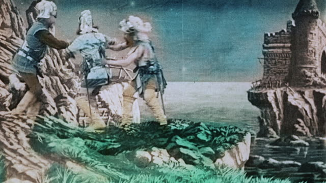 vídeos de stock e filmes b-roll de 1903 ws adventurers emerge from cave near castle and are turned back by goddess during the film, le royaume des fées (the kingdom of fairies) by georges melies - 1903