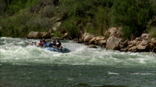Adventurers go white-water rafting at the Grand Canyon.