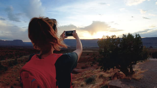 adventures in desert of usa southwest: woman hiking near canyonlands, moab - moab utah stock videos & royalty-free footage