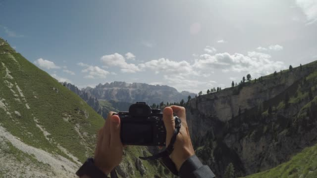 pov adventures of a man hiking on high mountain - film camera stock videos & royalty-free footage