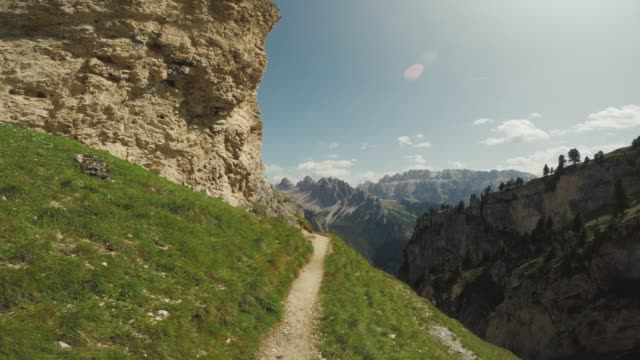 pov adventures of a man hiking on high mountain - sentiero video stock e b–roll