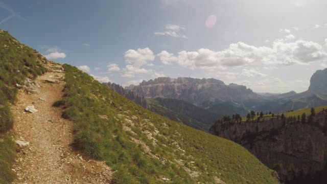 pov adventures of a man hiking on high mountain - dolomites stock videos & royalty-free footage