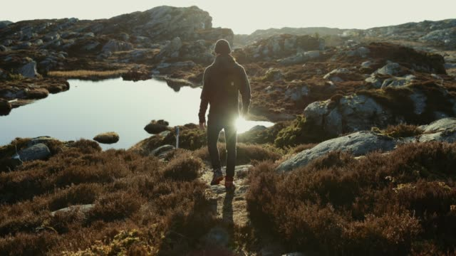 adventures of a man hiking on the mountain - on top of stock videos & royalty-free footage