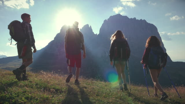 Adventures on the Dolomites: group of friends hiking