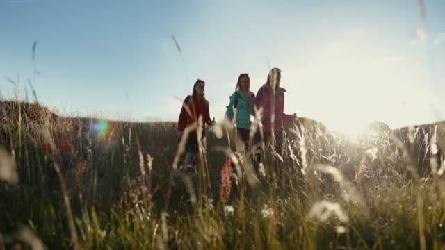 adventures on the dolomites: women hiking at sunset - alto adige video stock e b–roll