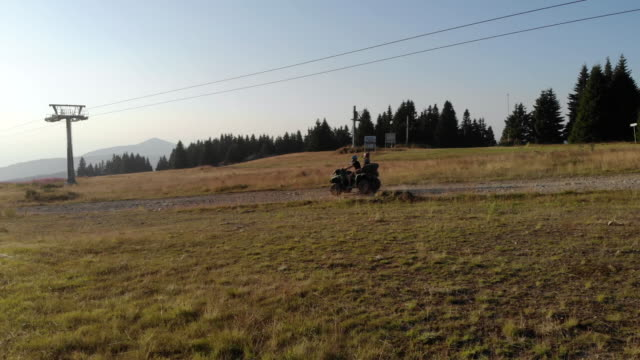 adventurous couple driving quad - quadbike stock videos & royalty-free footage