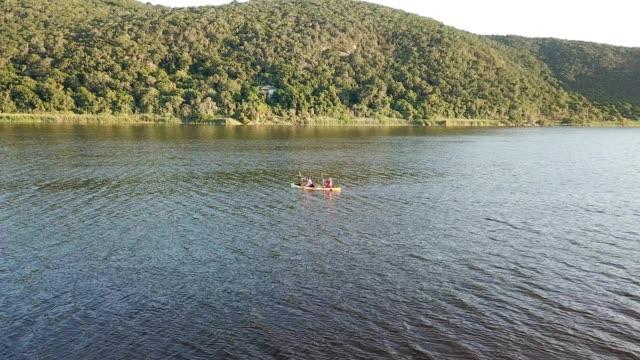 adventurous couple paddling on the lake - canoe stock videos & royalty-free footage