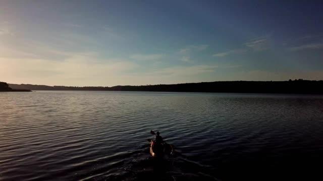 adventurous couple paddling on the lake - kayak stock videos & royalty-free footage