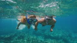 Adventurous couple snorkeling together