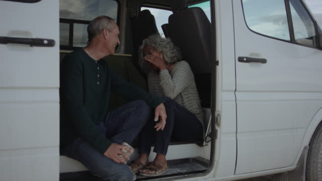 adventurous senior couple having a laugh in their campervan - two people stock videos & royalty-free footage