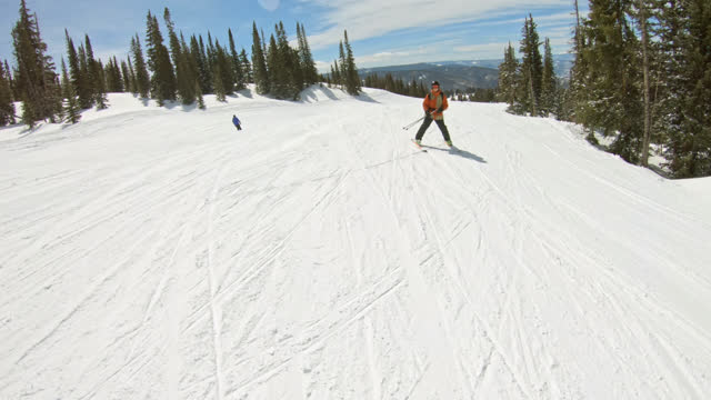 pov adventurous young boy skies down a snowy mountain slope and passes father - winter sport stock videos & royalty-free footage