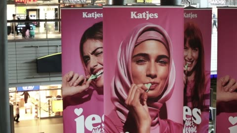 advertisements for a new line of vegetarian sweets by german candymaker katjes feature a muslim woman wearing a headscarf and three non-covered women... - frauenrechte stock-videos und b-roll-filmmaterial