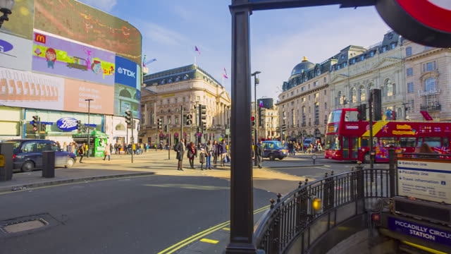 advertising boards in piccadilli circus and the entrance to piccadilly circus underground station in london. - piccadilly stock videos and b-roll footage