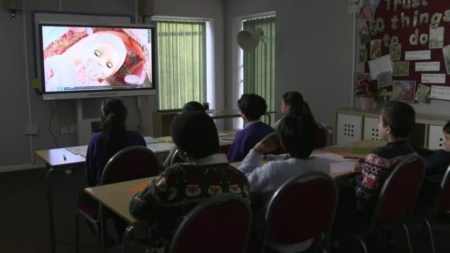 Adverts to be banned from perpetuating harmful stereotypes ENGLAND Birmingham INT Children in classroom watching adverts on screen Students listening...