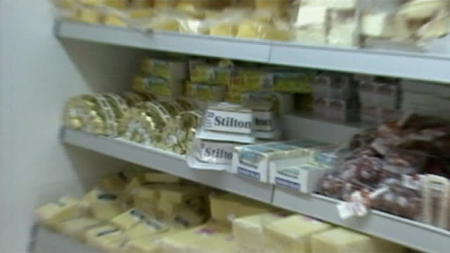 Advice to avoid fat 'should never have been introduced' AS170484017 / TX People in yoghurt aisle of supermarket 'Stilton' PULL OUT cheeses on shelf...