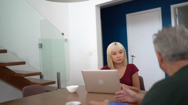 advisor talking to client at home at his home - direction stock videos & royalty-free footage