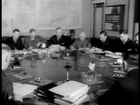 Advisory War Council seated at round table MS Three members MS three members Rt Hon Sir Robert Menzies sitting w/ John Curtain WWII