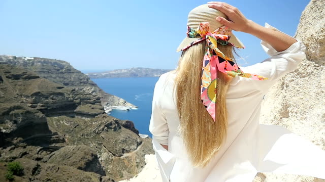 aegean seascape & volcano & tourist in hat - cappello video stock e b–roll