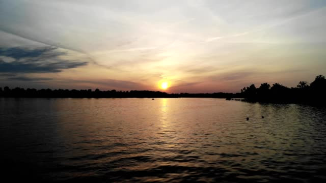aeiral view of a sunset over a lake in syracuse indiana - syracuse stock videos & royalty-free footage