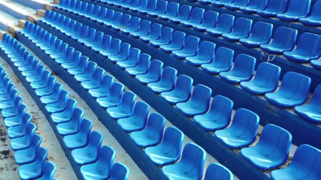 vídeos de stock e filmes b-roll de aeiral view of empty seats in a stadium - cadeira