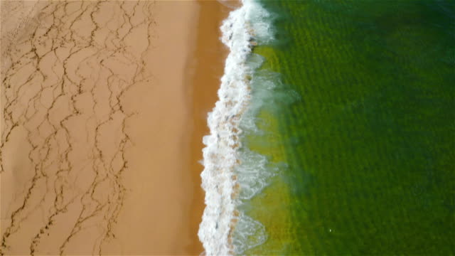 aereal view of a beach in portugal - tsunami stock videos & royalty-free footage
