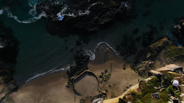 aerial: 360 degree view of secluded laguna beach - laguna beach, california - laguna beach california stock videos & royalty-free footage
