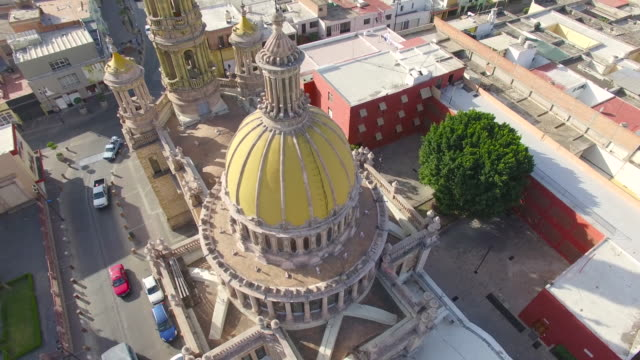 aerial 360 shot of the yellow dome of the san antonio de padua church in aguascalientes - dome stock videos & royalty-free footage