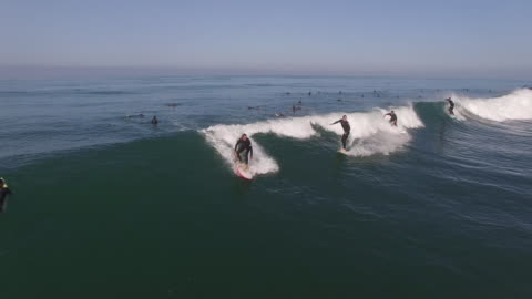 stockvideo's en b-roll-footage met party wave 4 surfers epic, aerial, 4k, 16s, 55of133, surfing, beach, california coast, ocean, waves crashing, wipeout, crash, sea, action sports, epic, stock video sale - drone discoveries llc 4k sports - surf