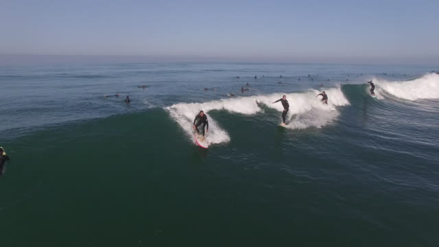 party wave 4 surfers epic, aerial, 4k, 16s, 55of133, surfing, beach, california coast, ocean, waves crashing, wipeout, crash, sea, action sports, epic, stock video sale - drone discoveries llc 4k sports - surfing stock videos & royalty-free footage