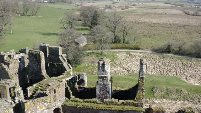 aerial 4k footage of caerlaverock castle , scotland, uk - moat stock videos & royalty-free footage