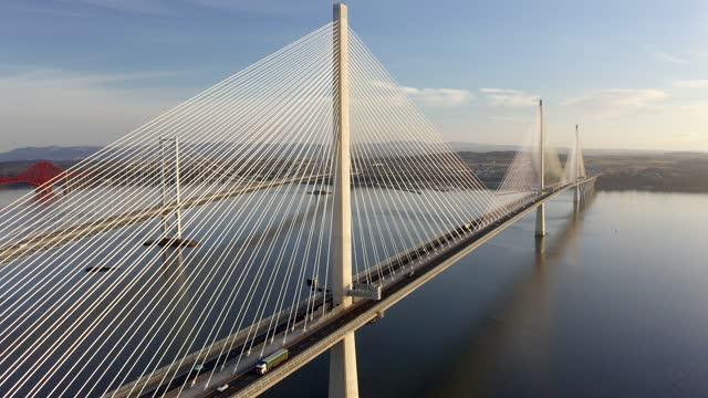 aerial 4k footage of queensferry crossing bridge, scotland, uk - film moving image stock videos & royalty-free footage