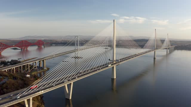 aerial 4k footage of three bridges crossing firth of forth in scotland, uk - film moving image stock videos & royalty-free footage