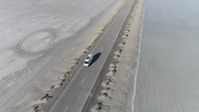aerial 4k: road trip in your campervan - bonneville salt flats stock videos and b-roll footage