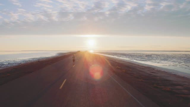 aerial 4k: run to the sun - bonneville salt flats stock videos and b-roll footage