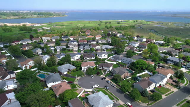 aerial 4k uhd video of oceanside, queens, new york city - bay of water stock videos & royalty-free footage