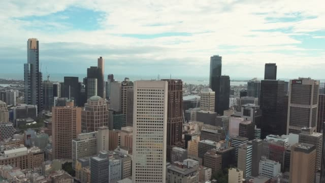 aerial 4k video of melbourne city center - international landmark stock videos & royalty-free footage