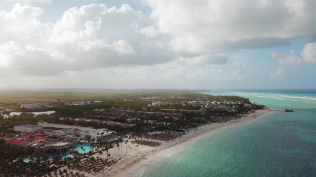 aerial: a building on a beach in punta cana - punta cana stock videos and b-roll footage