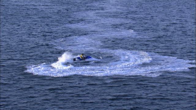 aerial a jet-ski rider in the bay of eilat, arava, israel - アラバ砂漠点の映像素材/bロール