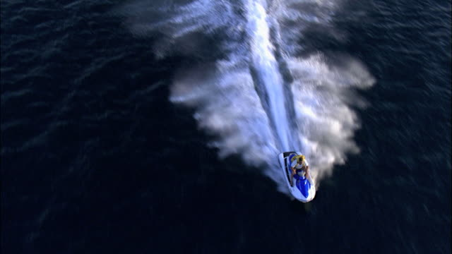 aerial a jet-ski rider in the bay of eilat, arava, israel - acquascooter video stock e b–roll